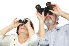 Couple looks through binoculars Stock Photos