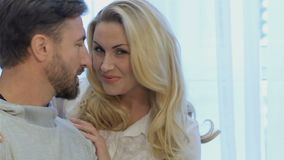 Couple looks at each other at home stock video footage