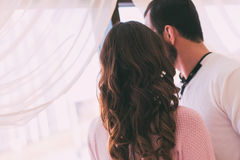 The couple looks out the window, rear view. Royalty Free Stock Photography