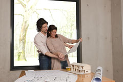 Couple looks at plans Stock Photography