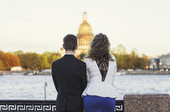 Couple looks at St. Isaac`s Cathedral in St. Petersburg Royalty Free Stock Image