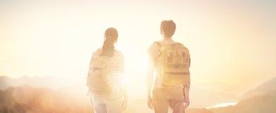 Couple looks at sunset. Toward adventure! Man and woman enjoying journey. Couple looks at sunset stock photo
