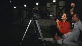 A couple looks through a telescope stock footage
