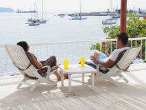 Couple in lounge chairs Royalty Free Stock Photo