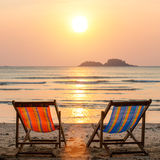Couple of loungers on sea beach. Travel. Couple of loungers on sea beach stock photography