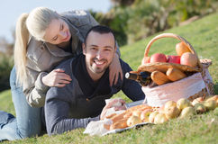 Couple lounging at picnic outdoors Royalty Free Stock Image