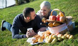 Couple lounging at picnic outdoors Royalty Free Stock Images