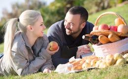 Couple lounging at picnic outdoors Royalty Free Stock Photos