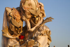 Couple in love. A masked couple in love, a rose in hand, during the Venice Carnival stock photography