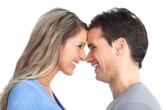 Couple in love. Happy smiling couple in love. Over white background Royalty Free Stock Images