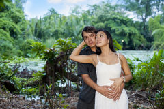 Couple in love. Romantic interracial couple in love out in the green Royalty Free Stock Photos
