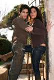 Couple in love. Young couple hugging in front of a gate Stock Image