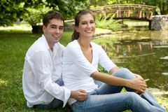 Couple in love. Young couple in love at the park on a sunny day royalty free stock photo
