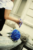 A couple in love. Against the blue bouquet. Blue shoes and blue flowers Stock Images