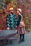 Couple in love in autumn leaves. Adventure, travel, tourism, hike and people concept - smiling couple walking with. Yellow leaves over natural background royalty free stock photos