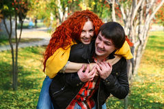 Couple in love in autumn park Stock Photos