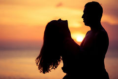 Couple in love back light silhouette on sea Stock Photography