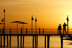 Couple in love back light silhouette at sea sunset Royalty Free Stock Images