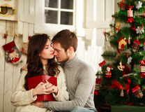Couple in love on background of Christmas decorations Stock Photo