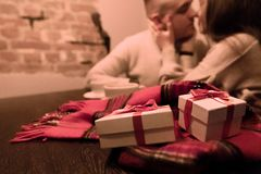 Young Couple in Love with Gifts. Valentine`s Day. Copy Space. Background royalty free stock photo