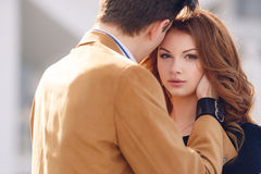 Couple in love on the background of the spring city. Royalty Free Stock Photography