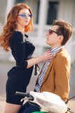 Couple in love on the background of the spring city. Outdoor fashion portrait of happy smiling couple in love having fun together end enjoy their love and Stock Images