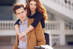 Couple in love on the background of the spring city. Outdoor fashion portrait of happy smiling couple in love having fun together end enjoy their love and Royalty Free Stock Photography
