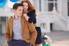 Couple in love on the background of the spring city. Outdoor fashion portrait of happy smiling couple in love having fun together end enjoy their love and Stock Photo