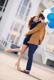 Couple in love on the background of the spring city. Royalty Free Stock Photos