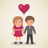 Couple in love with the ball in the shape heart Stock Photography