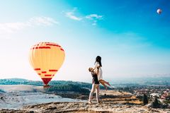 Couple in love among balloons. A guy proposes to a girl. Couple in love in Pamukkale. Couple in Turkey. Honeymoon in the mountains. Man and women traveling royalty free stock photos
