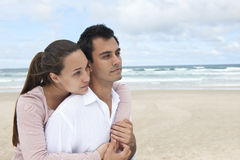 Couple in love on the beach Stock Photos