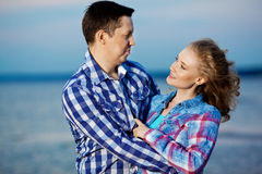 Couple in love on the beach. Beautiful young woman and man at th Royalty Free Stock Photography