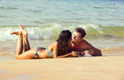 Couple in love on the beach Stock Image
