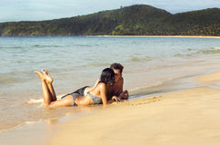 Couple in love on the beach Stock Photography