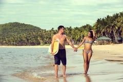 Couple in love on the beach Stock Photos