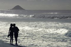 Couple in love on the beach in Rio de Janeiro royalty free stock photos