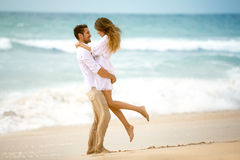 Couple in love on beach. Romantic vacation royalty free stock photography