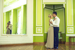 Couple in love in the beautiful interior. Couple in love in the beautiful classic interior stock photos
