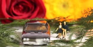 Couple in love. Beautiful shot showing miniature couple with car in nature Stock Image