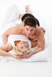 Couple in love in bed looking at the camera Royalty Free Stock Photo