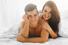 Couple in love in bed Stock Photo