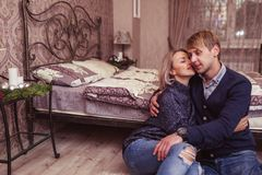 Couple in love in bedroom Stock Images