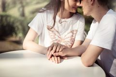 Couple in love - Beginning of a Love Story. A man and a girl romantic date in a park Stock Images