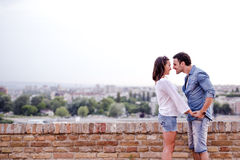 Couple in love being close to each other outdoors Royalty Free Stock Image