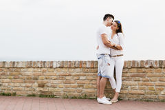 Couple in love being close to each other outdoors Stock Photos