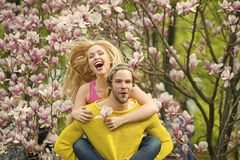 Couple in love in blossoming flower, spring. Man and women in spring, easter. Spring, nature and environment. Sensual women and men in magnolia bloom. Love and stock photo