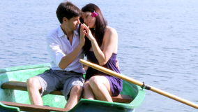 Couple in love on boat in vacation on lake in Italy Stock Photography