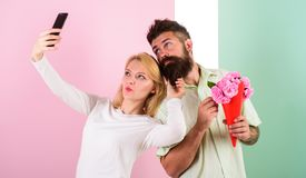 Couple in love bouquet dating celebrate anniversary relations. Sharing happy selfie. Capturing moment to memorize. Woman. Capturing happy moment boyfriend bring Royalty Free Stock Photos
