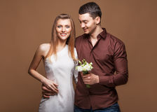 Couple in love with a bouquet of flowers Royalty Free Stock Photos